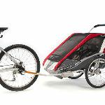 Chariot Cougar 2 Double Twin Bike Carrier Trailer  ·Double bike trailer rental. Holds 2 children & up to 100 lbs  ·Includes rain & bug cover, storage and bike attachment  ·5 pt seatbelt  ·Folds for travel; Age 1 & up  ·Rented separately, but can convert to jogging stroller, hiking carrier, X-C Ski