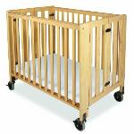 "Solid Wood Compact Folding Crib  ·Solid wood compact crib rental includes mattress, mattress cover and fitted sheet.   ·Complies with all current safety regulations and has fixed sides.   ·Compact, sturdy, rolls and folds.  ·Sleeping surface of 24"" x 38"""